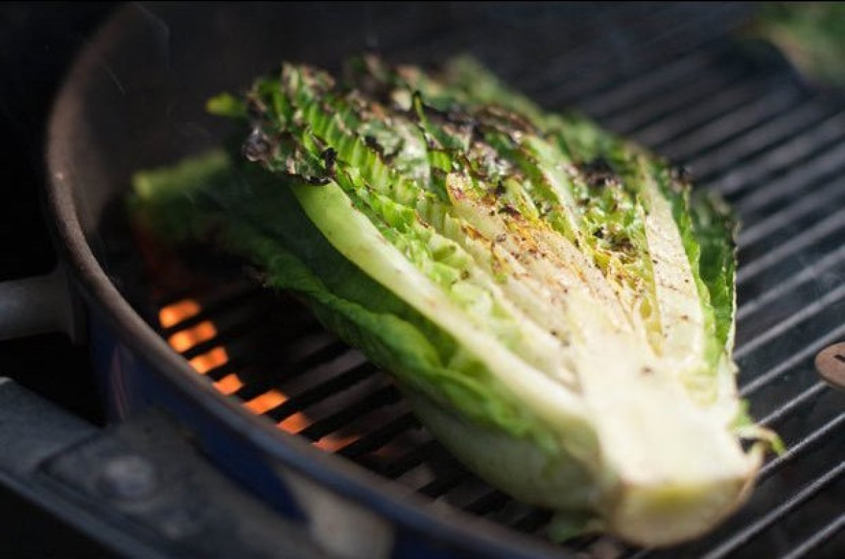 Add a slight char to your lettuce by grilling a head of Romaine lettuce or butter lettuce. Simply halve the heads and brush w