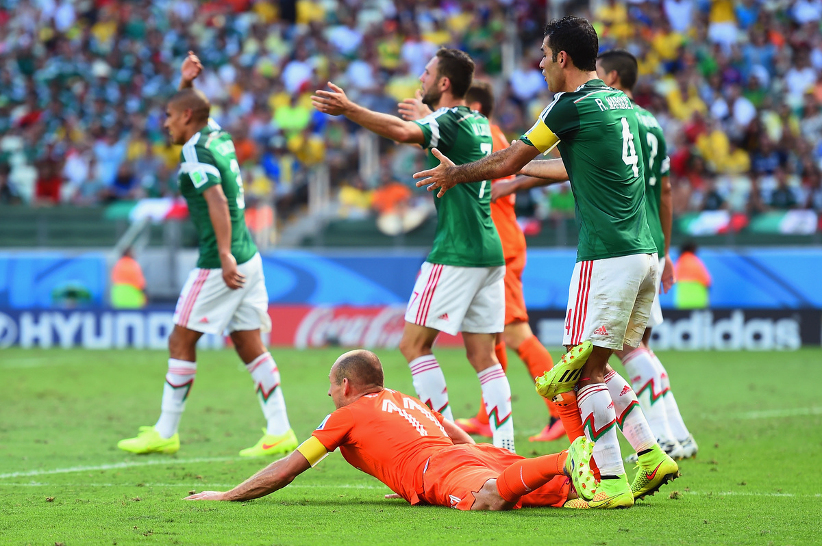 FORTALEZA, BRAZIL - JUNE 29: Rafael Marquez of Mexico reacts after a challenge on Arjen Robben of the Netherlands resulting i