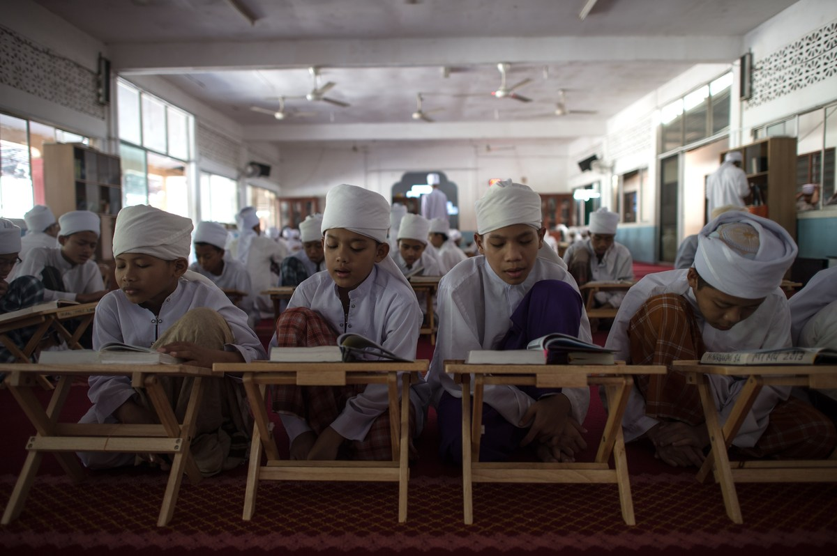 Malaysian religious students read the Koran at school during the Muslim holy fasting month of Ramadan in Hulu Langat, near Ku
