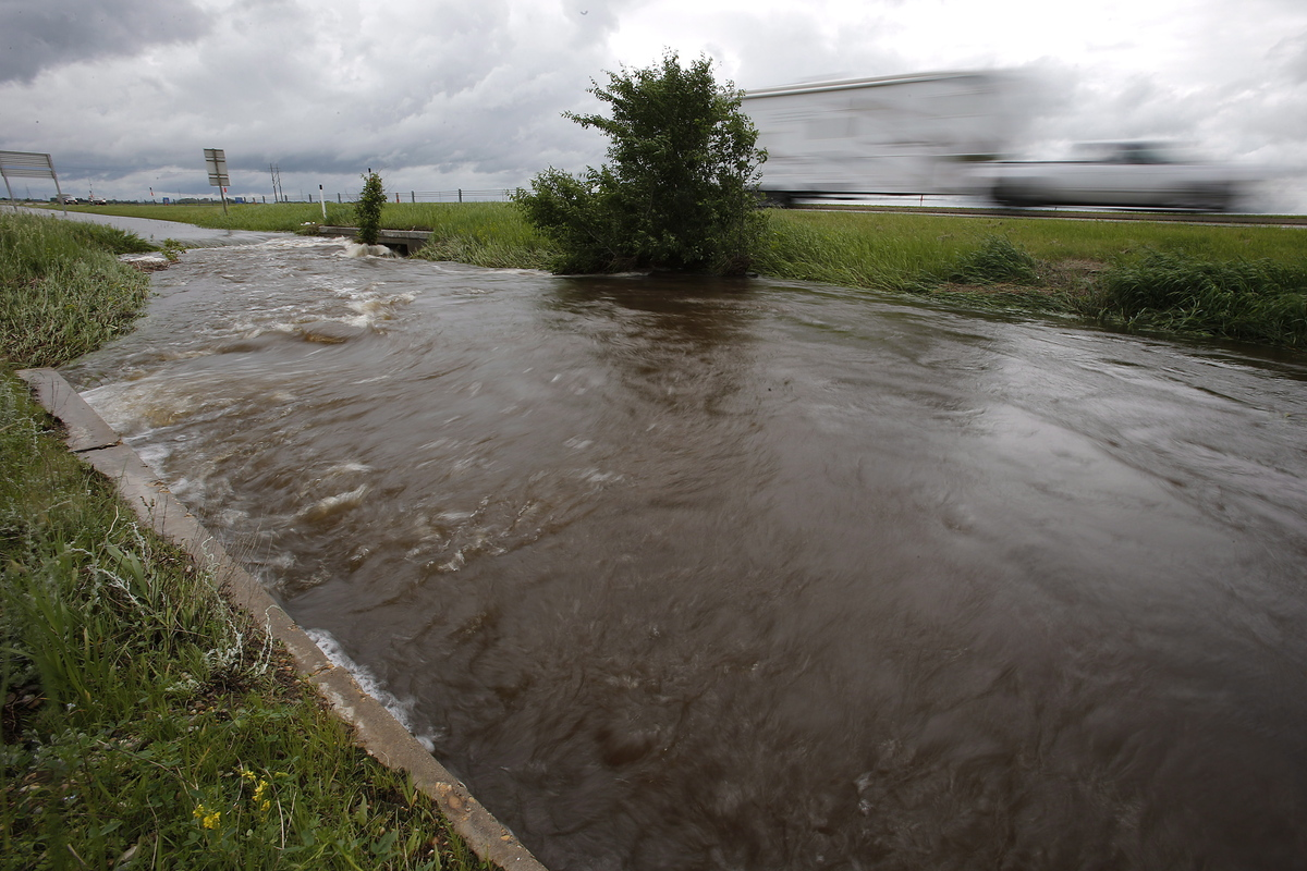 Ditches and culverts are at capacity due to overland flooding in Brandon and surrounding southwest Manitoba, Monday, June 30,