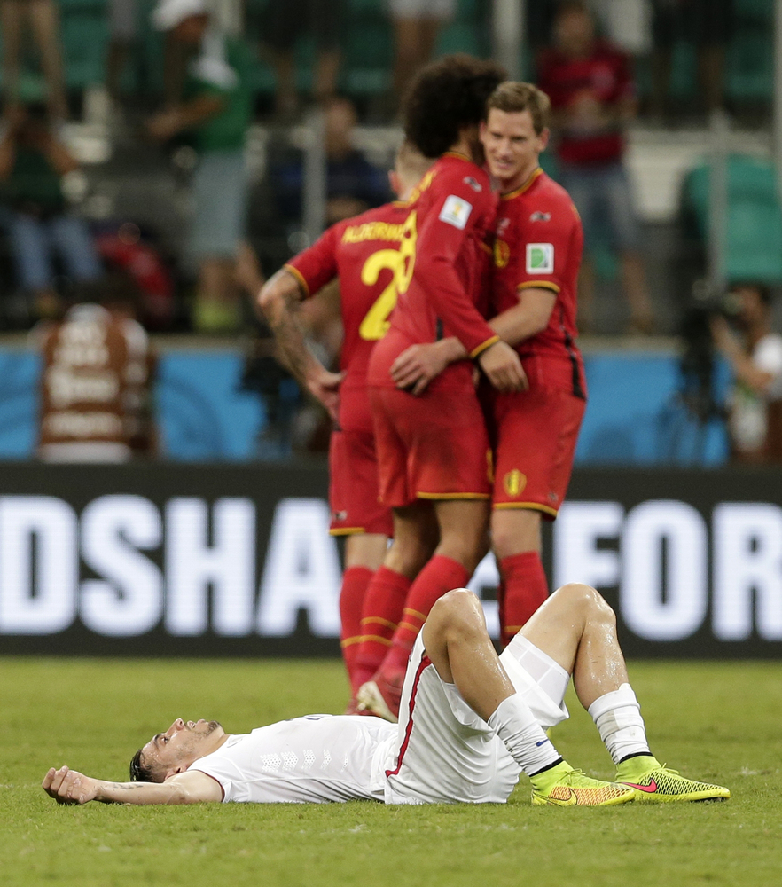 United States' Geoff Cameron lies on the pitch after Belgium defeated the USA 2-1 in extra time to advance to the quarterfina