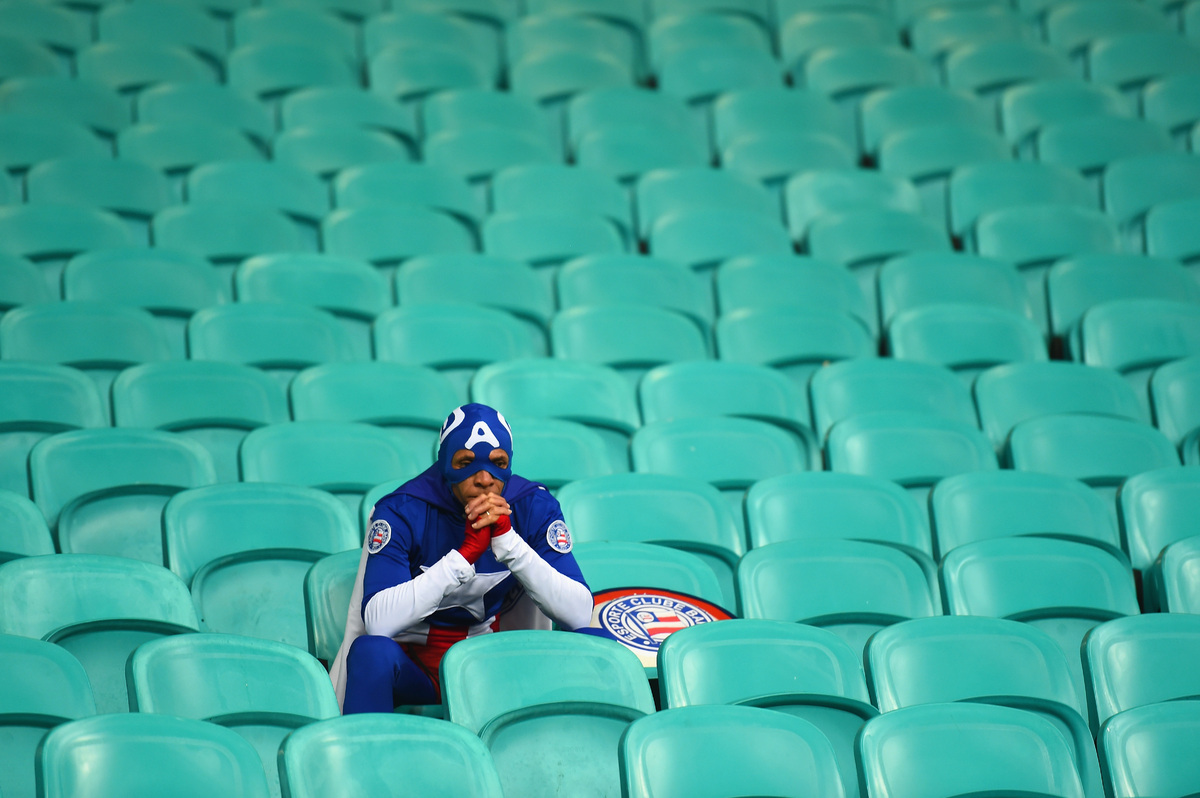 A fan dressed as Captain America looks on after Belgium's 2-1 victory in extra time during the 2014 FIFA World Cup Brazil Rou