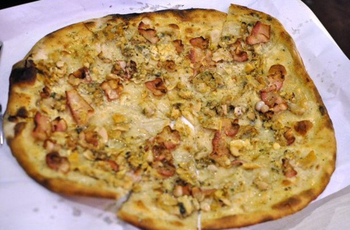 Just the fact alone that the tiny city of New Haven is home to America's best pizza, the white clam pie at the legendary Fran