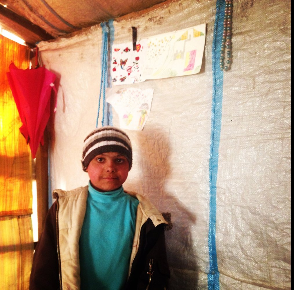 Lina's son, whose drawings hang on the walls of his family's tent. Lina, who I interviewed for the Woman Alone report, told m