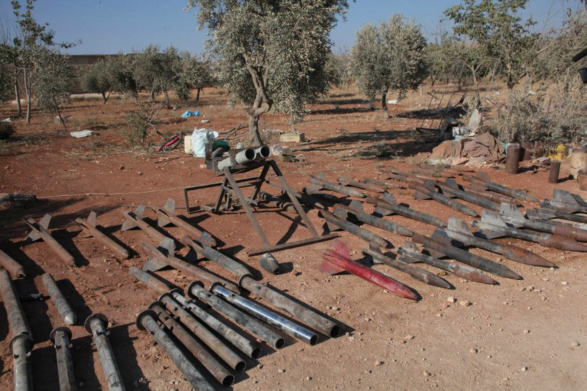 Weapons that the Syrian official news agency SANA says were captured by Syrian government forces in Kafr Saghir are seen outs