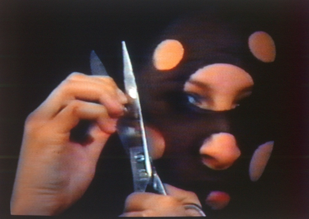 Sanja Iveković. Personal Cuts, 1982. Video, black and white and color, audio, 3:35 min. Collection espaivisor gallery.  (Corp