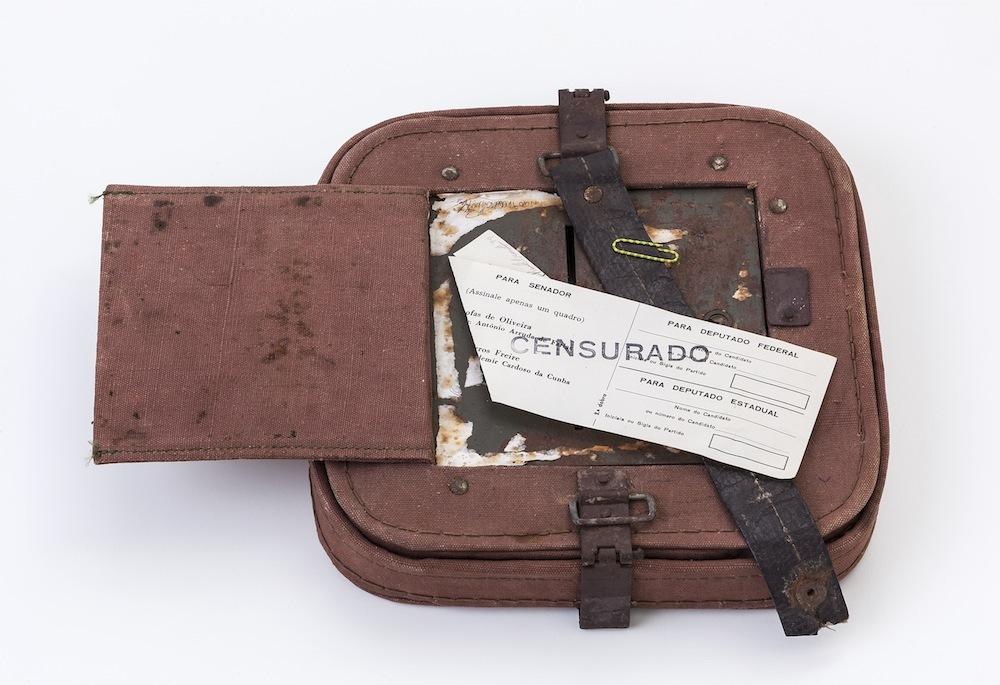 Paulo Bruscky. Luto/Censurado, 1974. Stamped ballot and ballot box, 14.5 x 27 x 4.5 cm. Collection of Lili and João Avelar. P