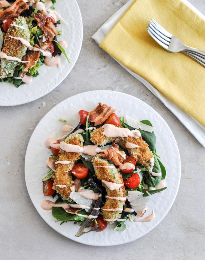 """<strong>Get the <a href=""""http://tastykitchen.com/blog/2013/02/crispy-avocado-bacon-and-tomato-salad/"""" target=""""_blank"""">Crispy"""