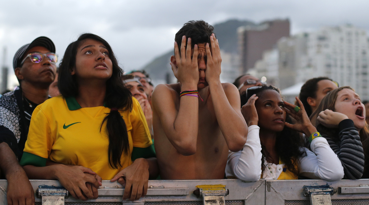 Soccer fans of the Brazil national soccer team watch a live broadcast of the World Cup third-place soccer match between Brazi
