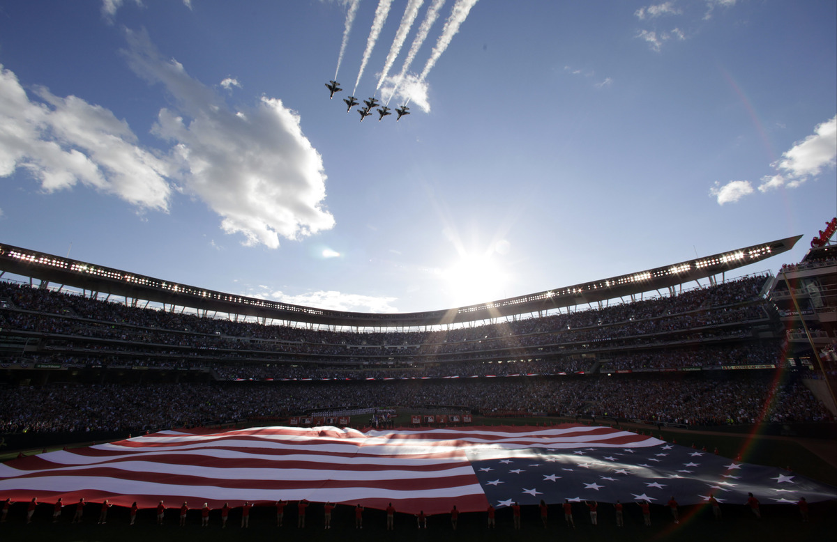 The U.S. national anthem is played before the MLB All-Star baseball game, Tuesday, July 15, 2014, in Minneapolis. (AP Photo/P