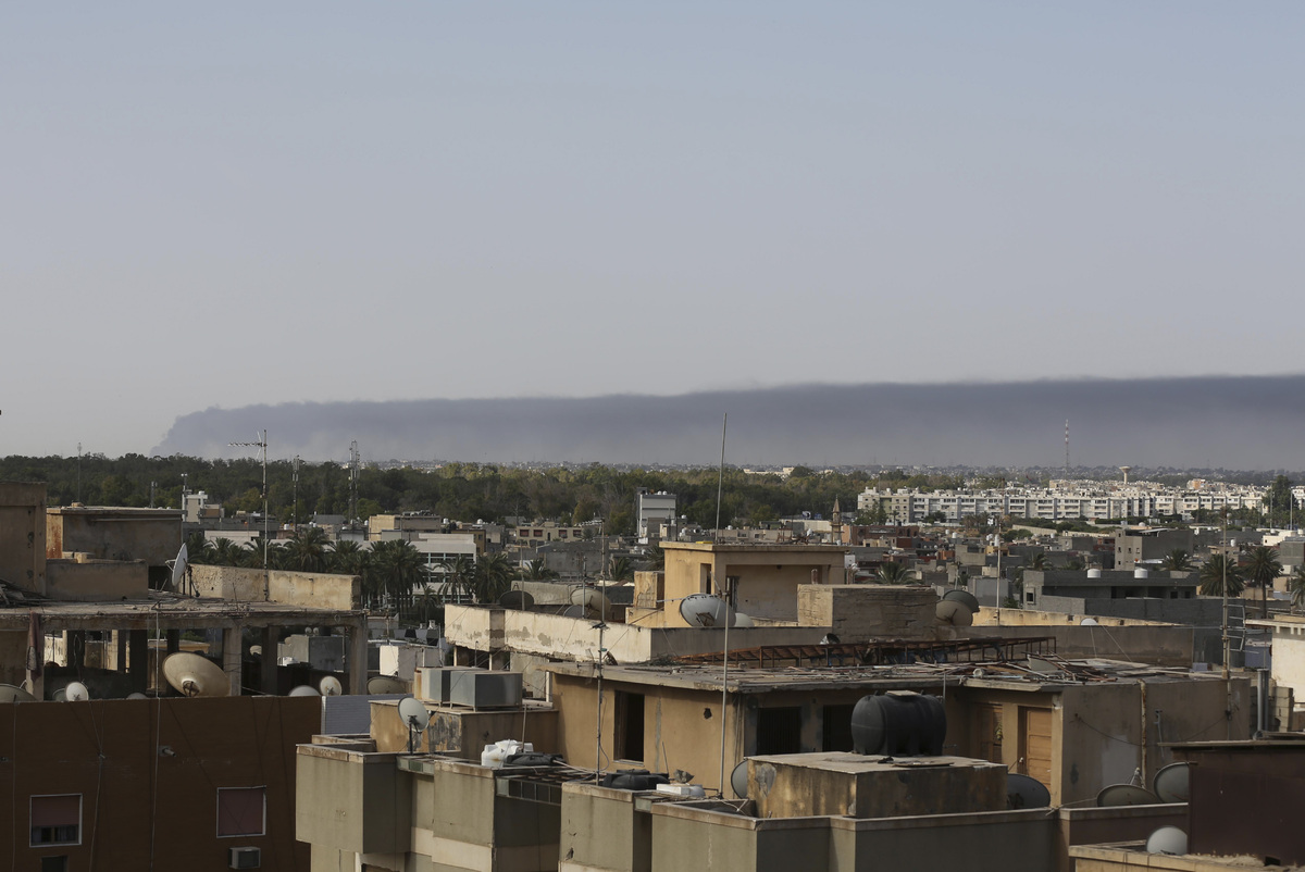 Smoke rises on the horizon in Tripoli, Libya, on July 13, 2014. (AP Photo/Mohammed Ben Khalifa)