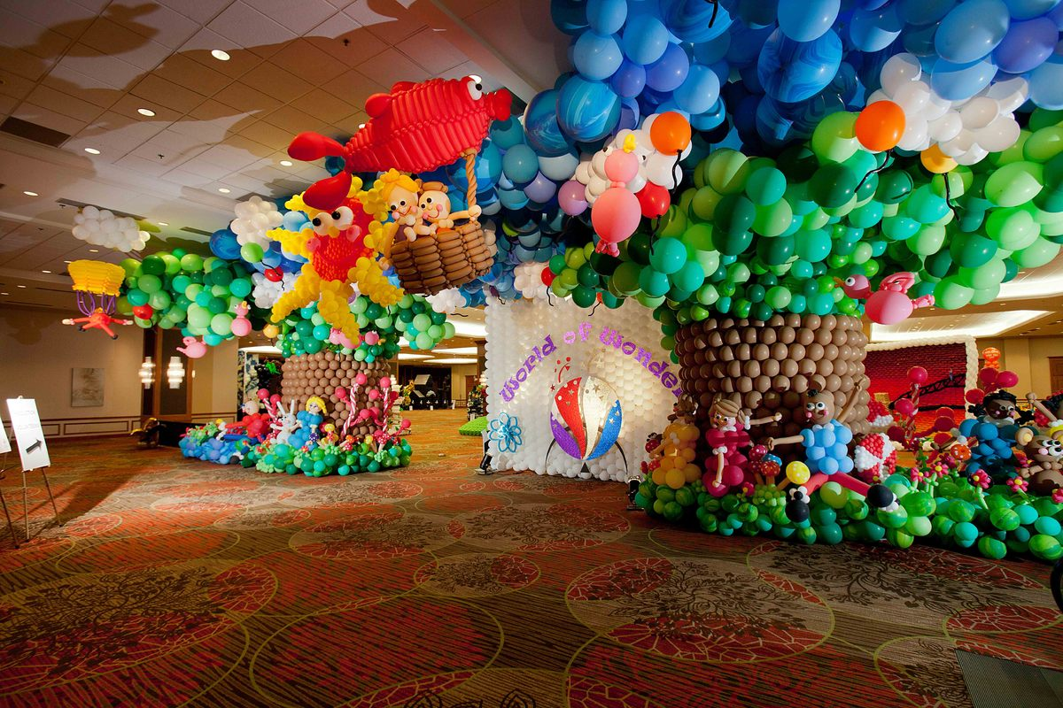 """Attendees entered the 2012 Festival of Balloons through this dream-like wonderland featuring balloon """"trees,"""" """"children,"""" and"""