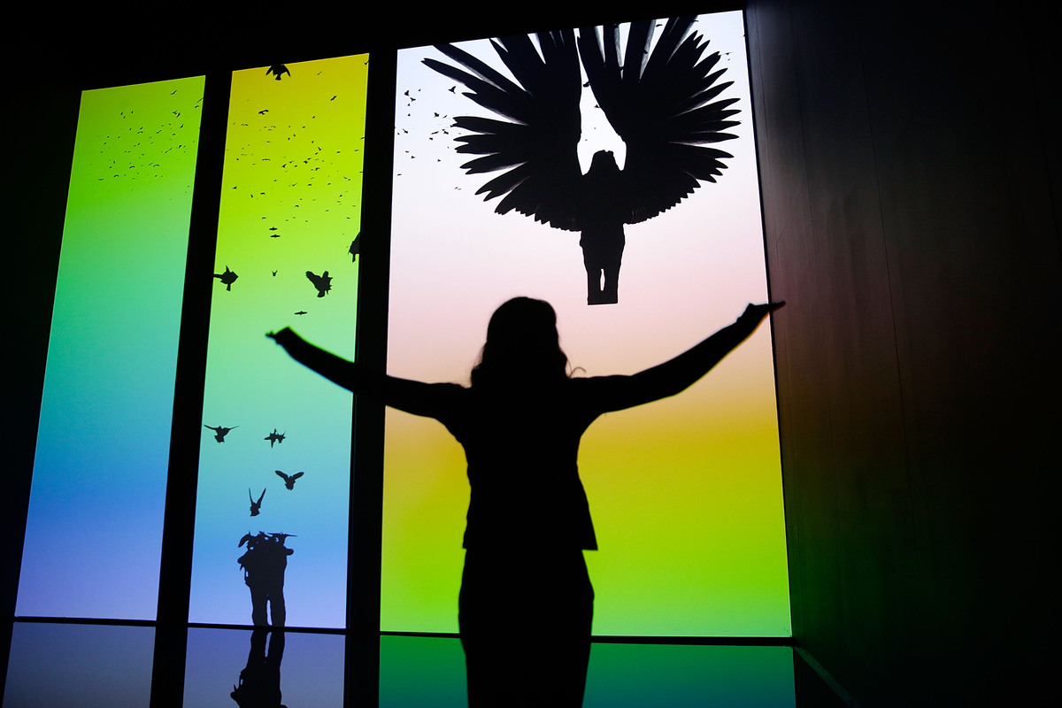 Chris Milk's 'The Treachery of Sanctuary' seen on display at the Barbican's Digital Revolution exhibition on July 2, 2014 in