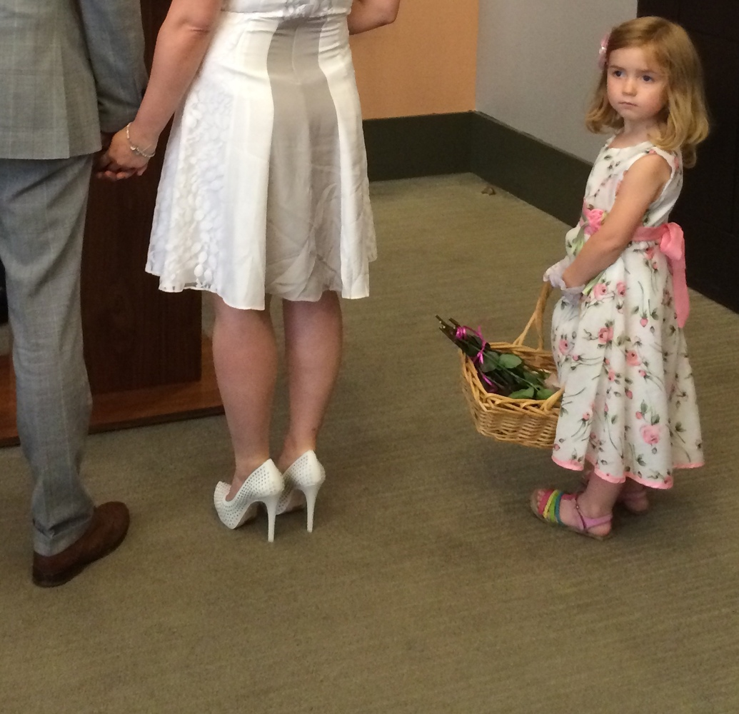 <strong>When it came time to stand next to the bride and groom, Annabelle got a little shy. So mom came to the rescue and hel
