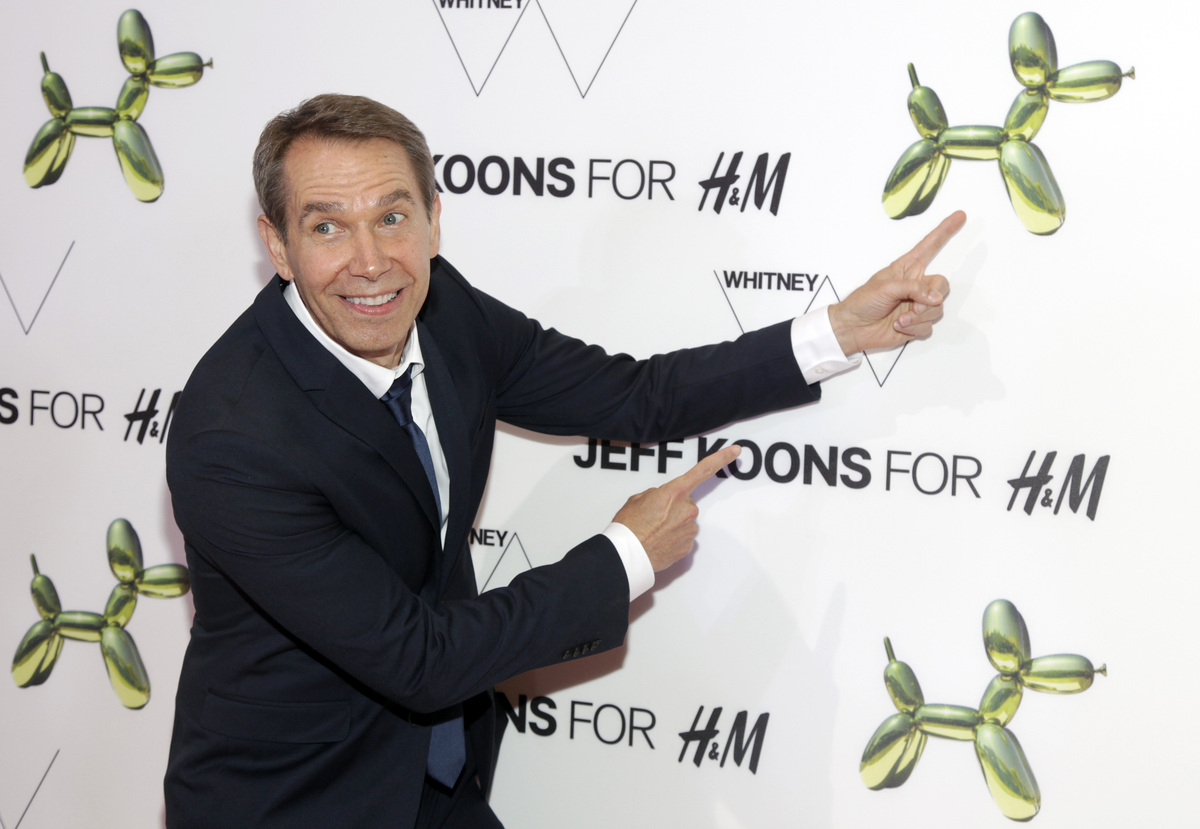 Artist Jeff Koons attends the opening of the H&M Fifth Avenue flagship store on Tuesday, July 15, 2014, in New York. (Pho