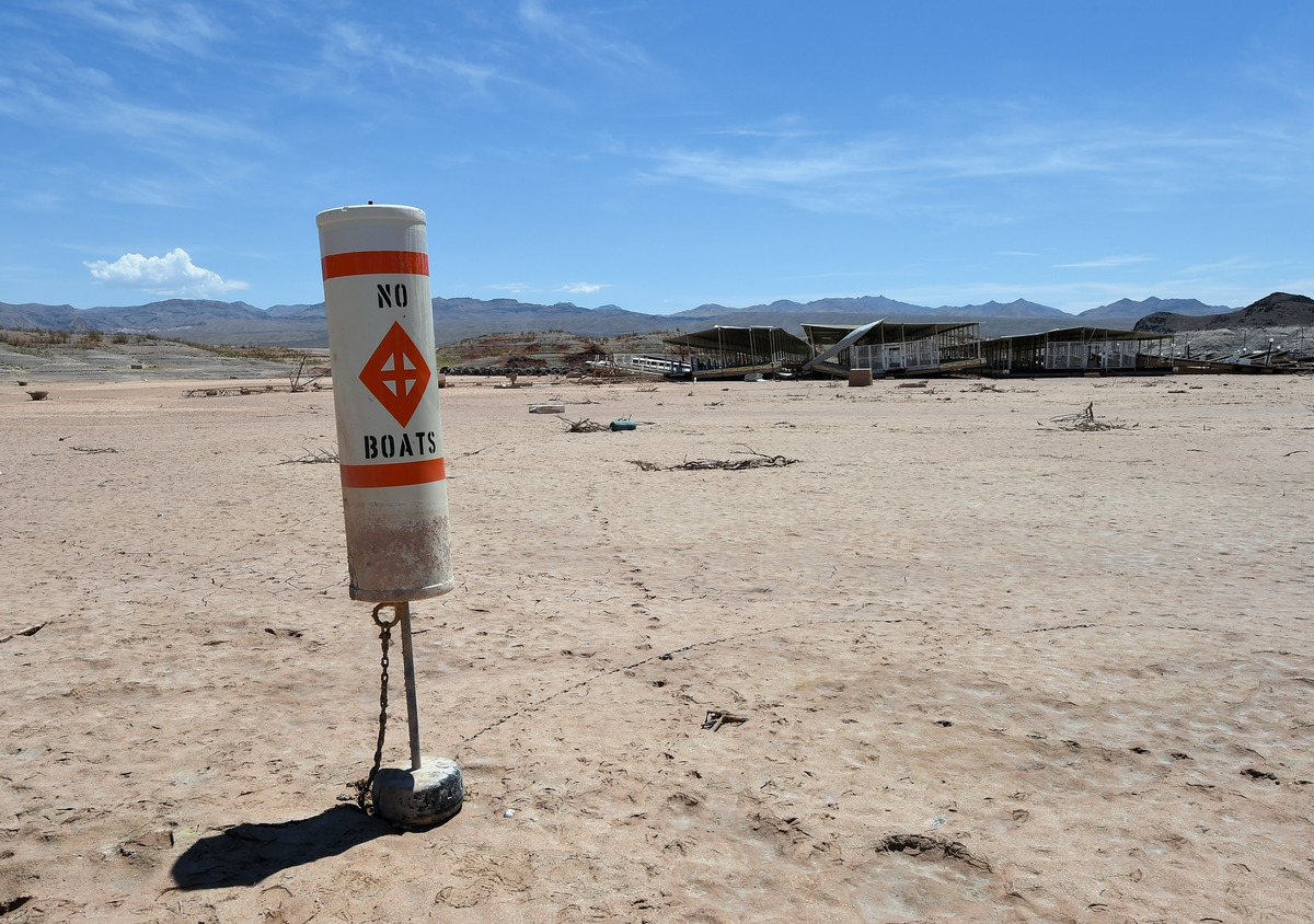 "A buoy warning ""no boats"" stands on dirt at the abandoned Echo Bay Marina on July 13, 2014 in the Lake Mead National Recreati"