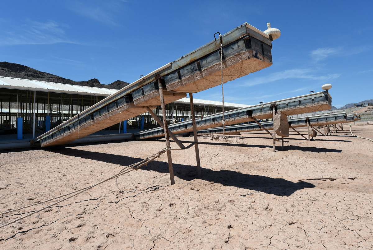 Empty boat slips protrude from the dock at the abandoned Echo Bay Marina on July 13, 2014 in the Lake Mead National Recreatio