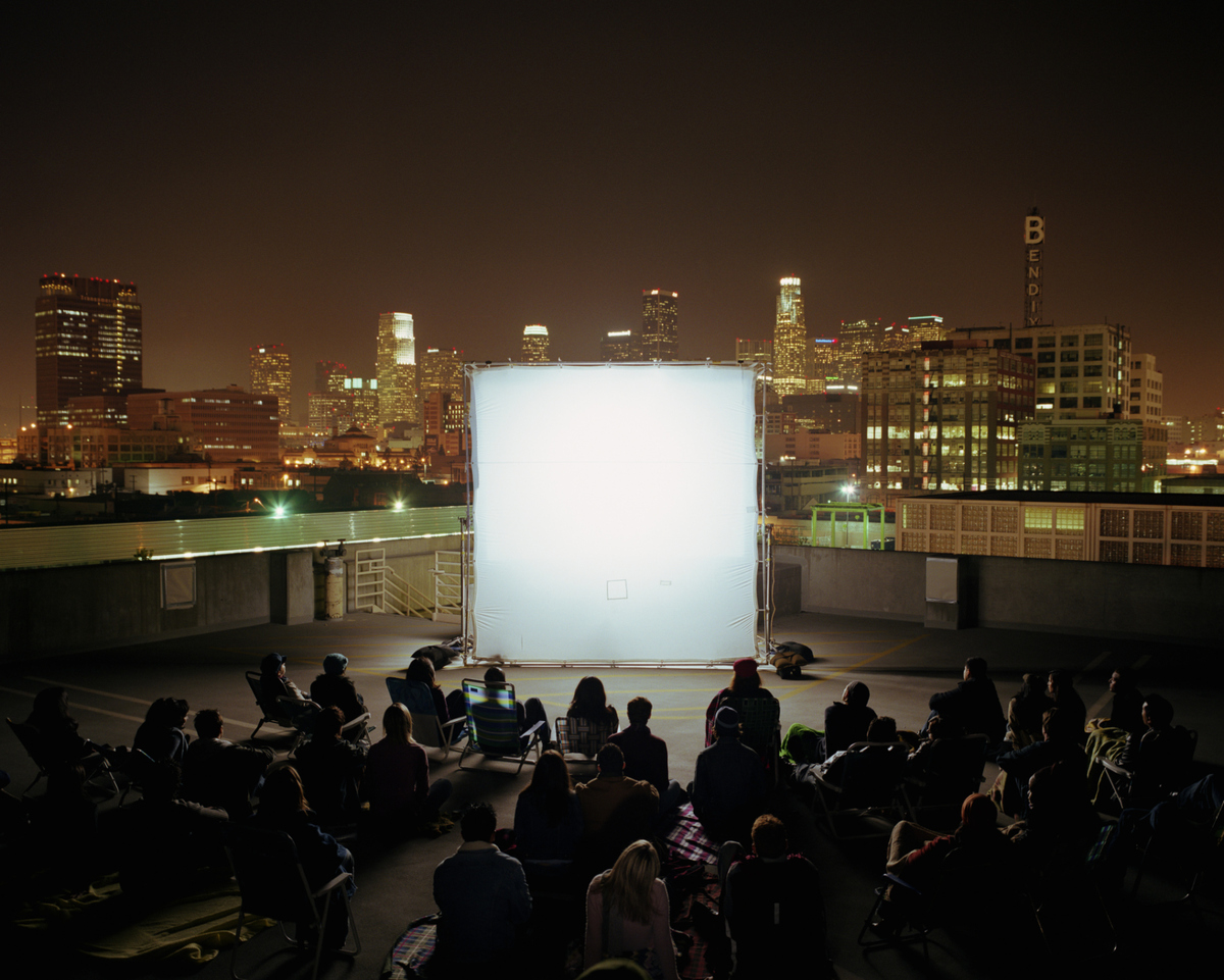 Curl up on a blanket (not too close though) and enjoy a screening of a classic movie at a nearby local park or green space in