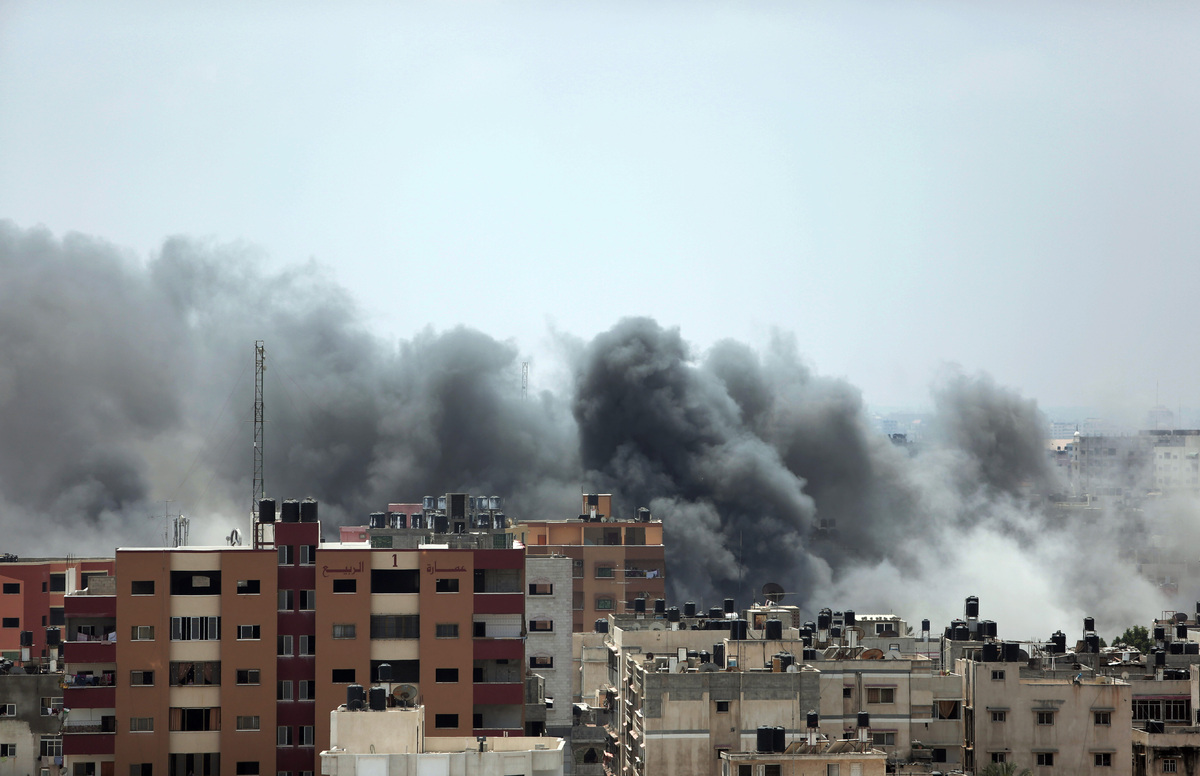 Smoke rises after an Israeli missile strike hit Gaza City, Monday, July 21, 2014.