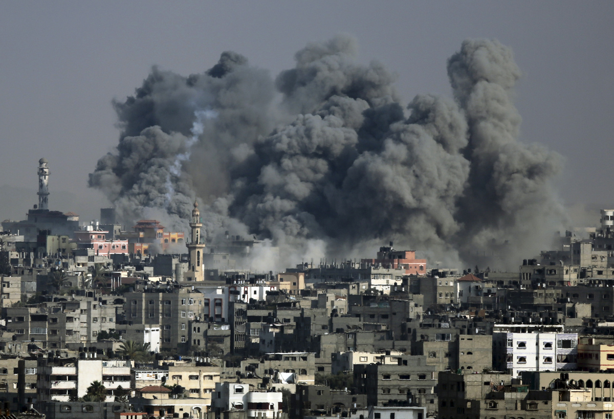 Smoke from an Israeli strike rises over Gaza City, Tuesday, July 22, 2014. Israeli airstrikes hit a wide range of locations a