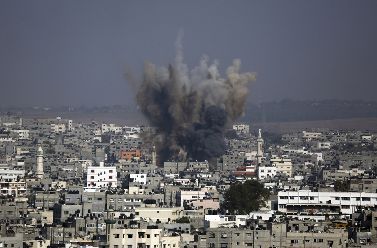 Smoke and debris from an Israeli strike rise over Gaza City, Tuesday, July 22, 2014, as Israeli airstrikes pummeled a wide ra
