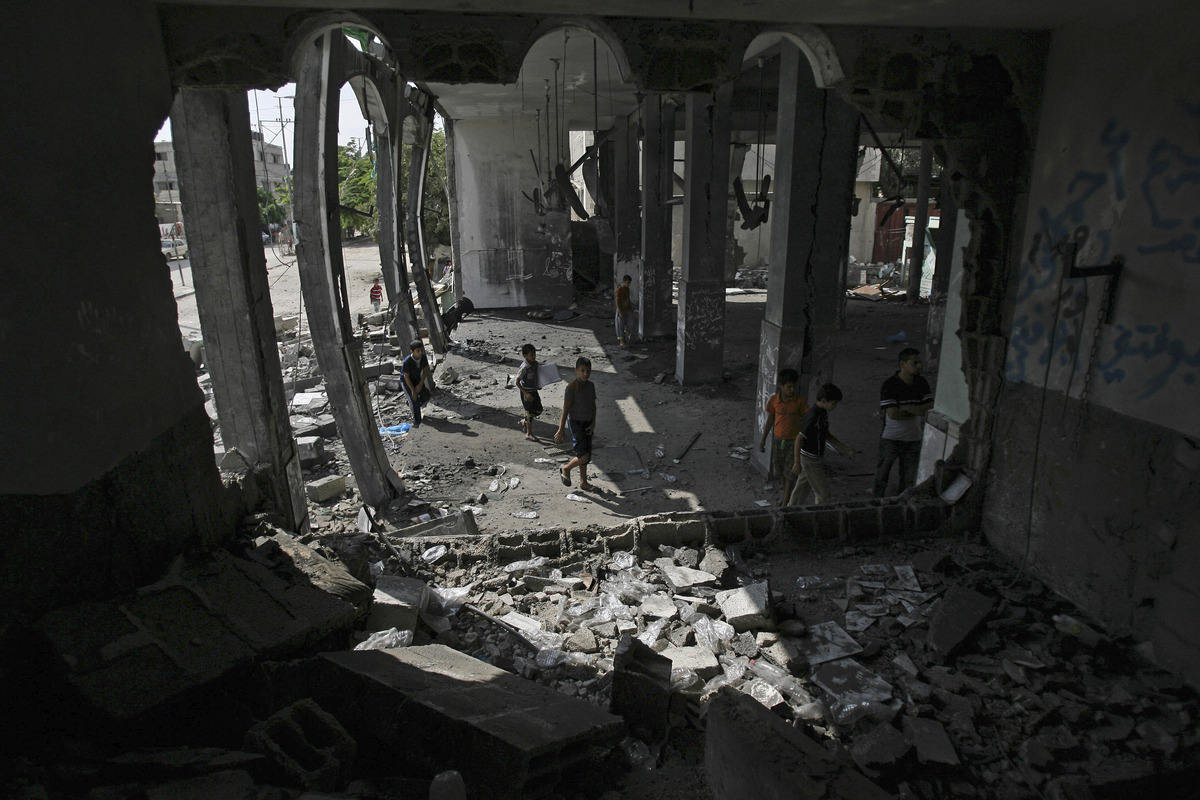 Palestinian children inspect the Al Farouk mosque destroyed by an overnight Israeli strike, in Rafah, in the southern Gaza St