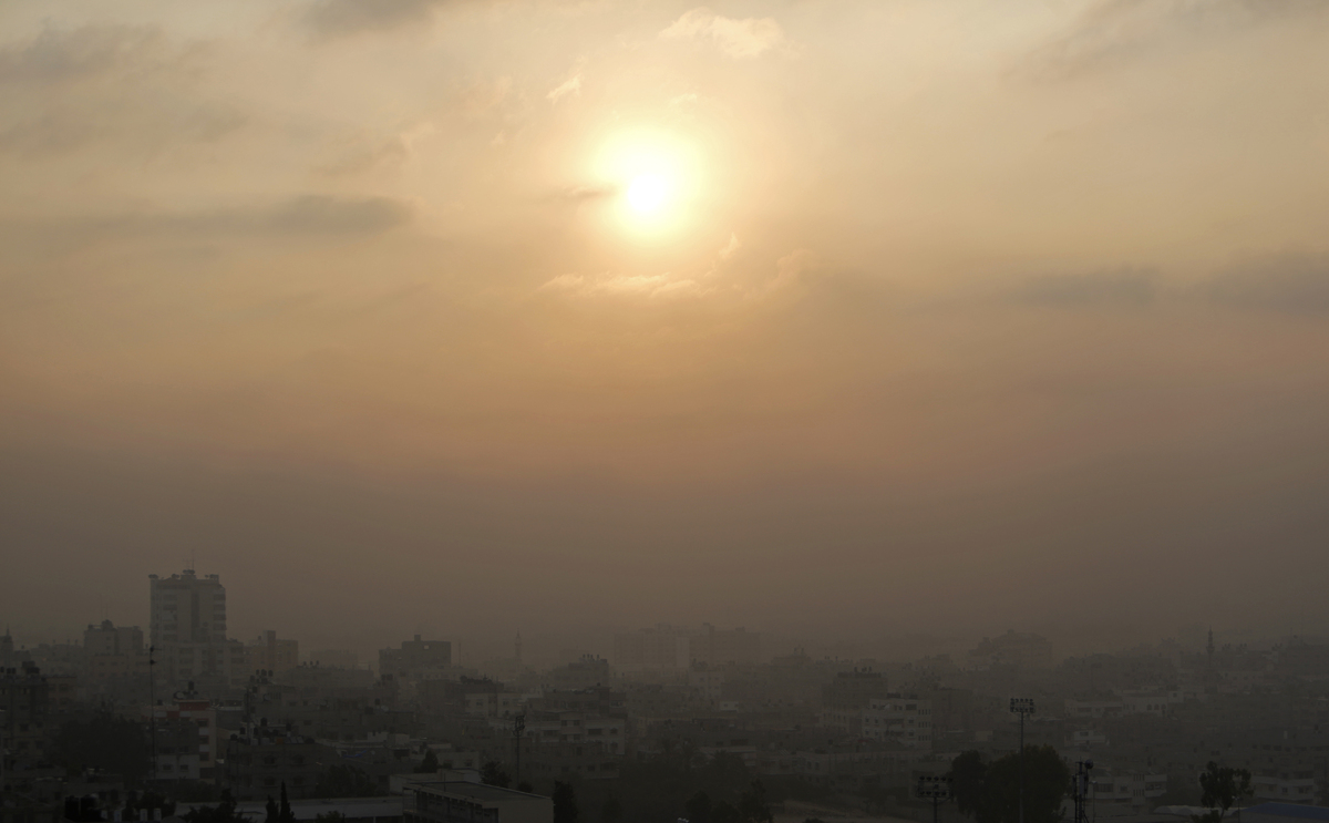 Smoke from Israeli strikes rises over Gaza City, in the Gaza Strip, Tuesday, July 22, 2014. A police spokesman said Israeli a