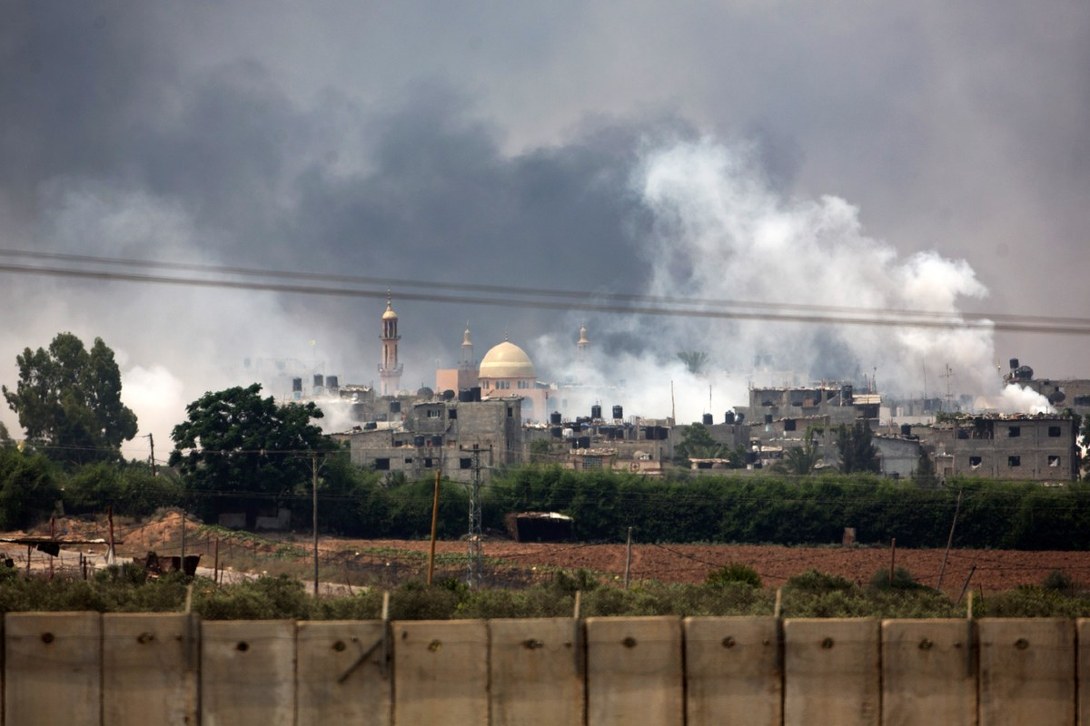 A picture taken from the southern Israeli Gaza border shows smoke billowing from the coastal Palestinian enclave during shell