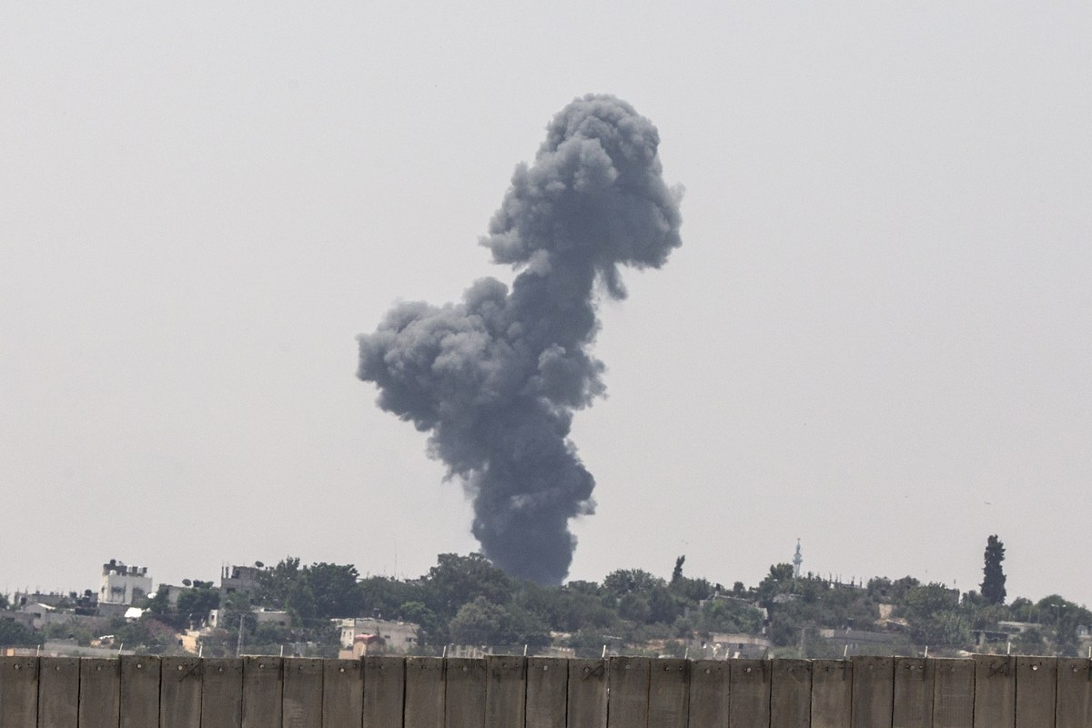 A picture taken from the southern Israeli Gaza border shows smoke billowing from the coastal Palestinian enclave following an