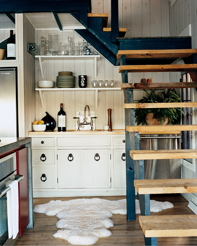 Shelves also work when dealing with an awkward space, like underneath a staircase.  <i>For more kitchen ideas, visit <a href=