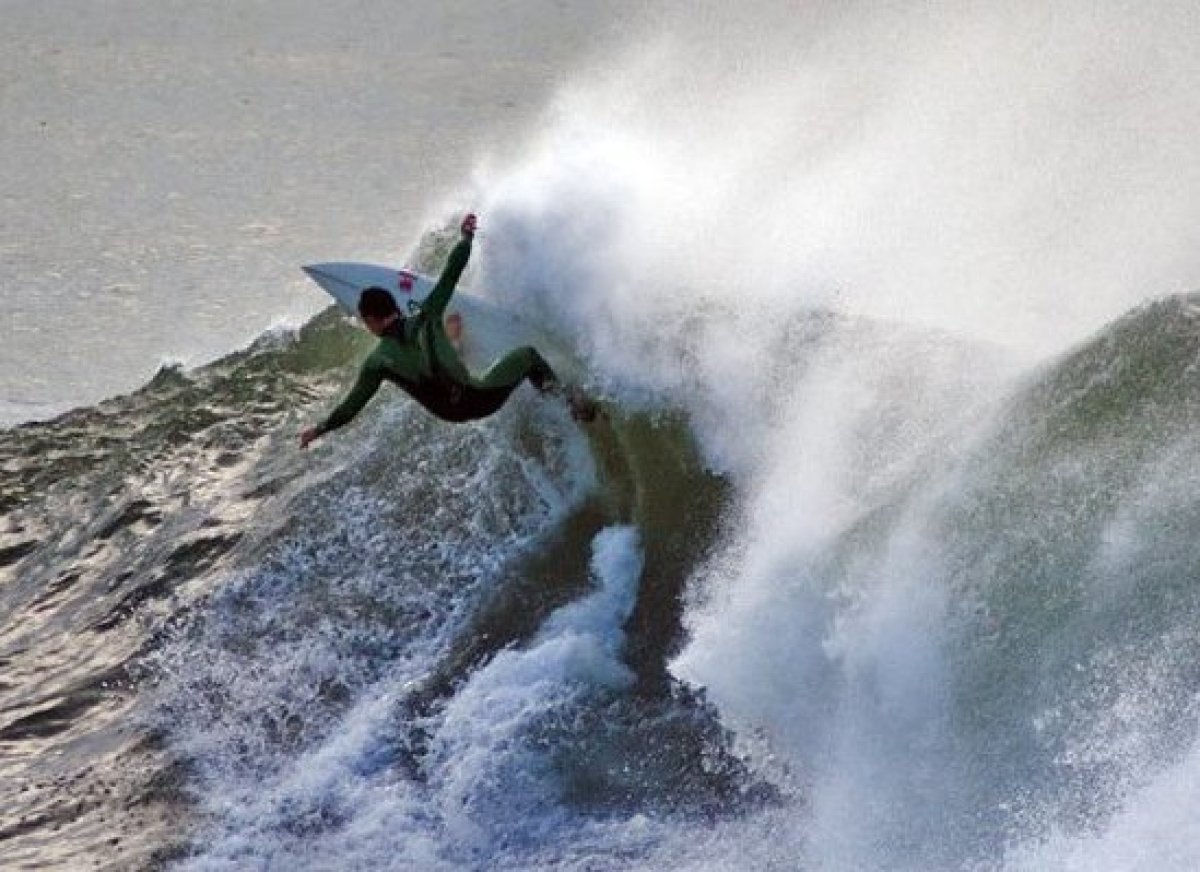 <em>Photo Credit: Ian Walsh Surfing Hurricane Bill, Newport, RI by Attribution-NonCommercial License</em>  While Rhode Isla