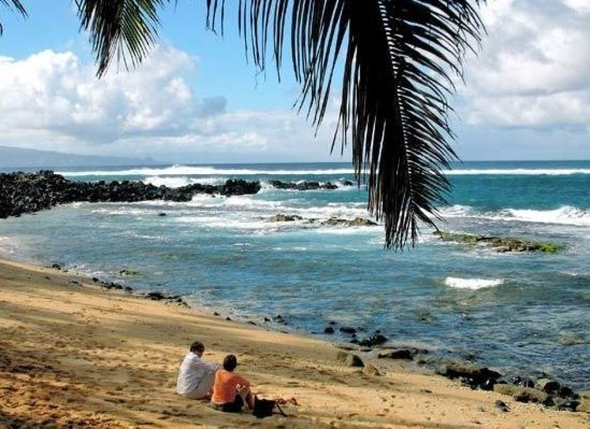 <em> Photo Credit: An Hawaiian Holiday by Attribution License</em>  Once a booming plantation town, Paia is comprised of mi