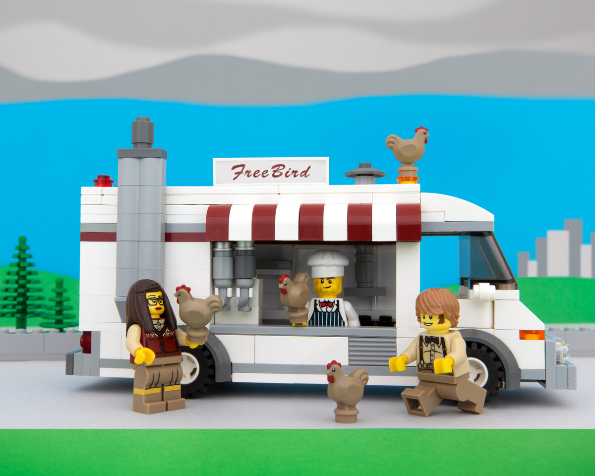 """Free-range chickens flee gluten-free hipsters at the FreeBird food truck."""