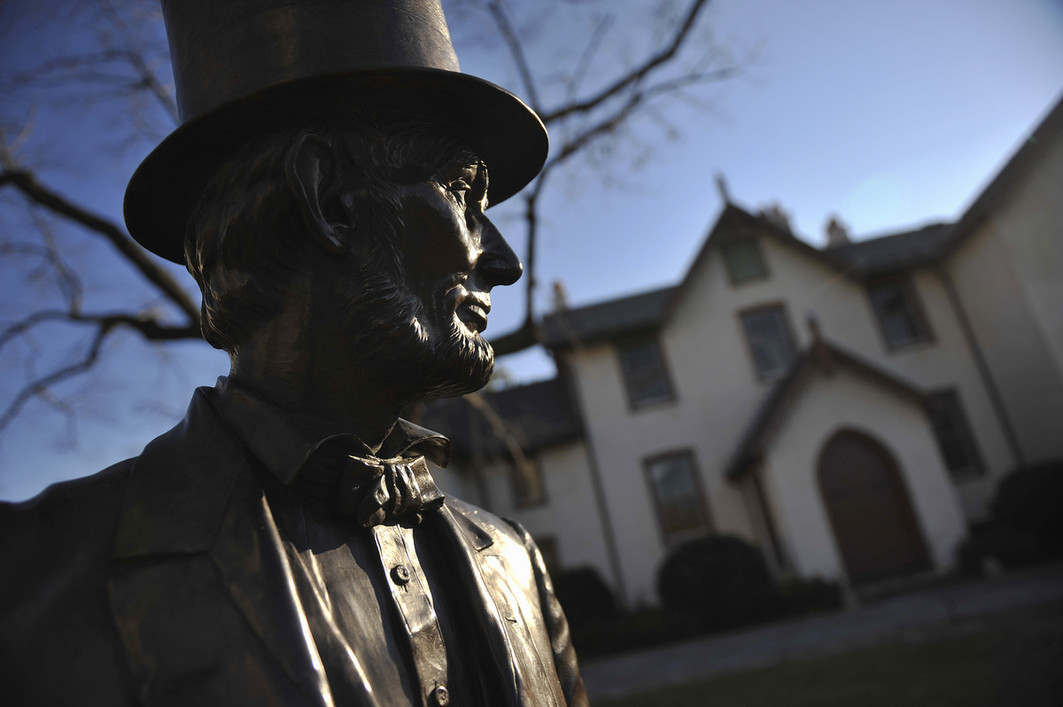 A statue of Abraham Lincoln stands outside the Washington, D.C. cottage he lived in while getting away from the White House d