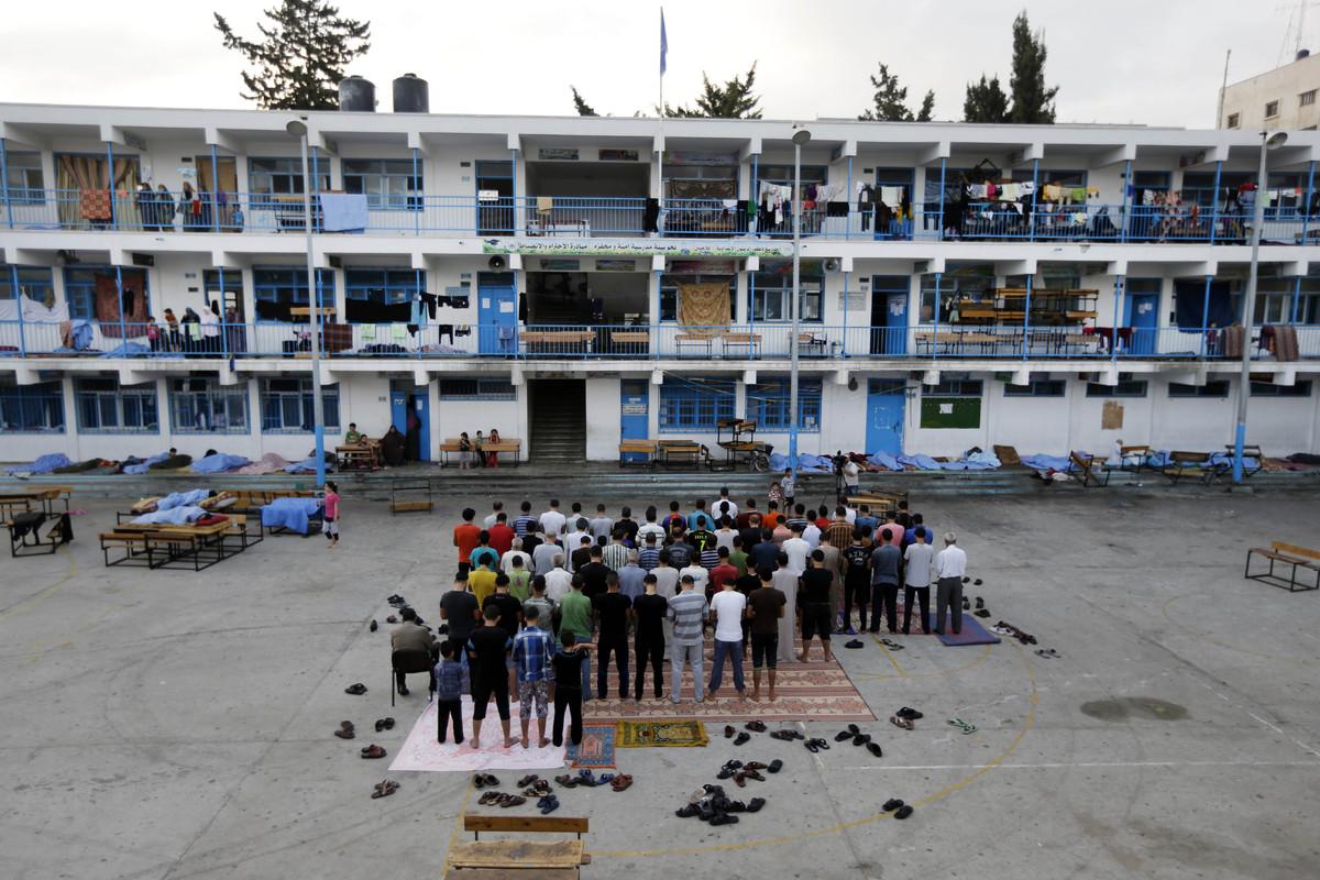 Palestinians pray in the courtyard of a U.N. school in Gaza City, Monday, July 28, 2014. The school, one of dozens of emergen