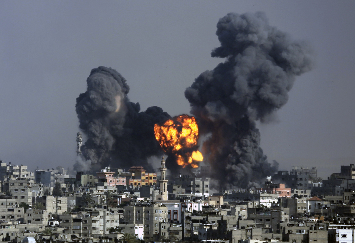 Smoke and fire from the explosion of an Israeli strike rise over Gaza City, Tuesday, July 22, 2014, as Israeli airstrikes pum
