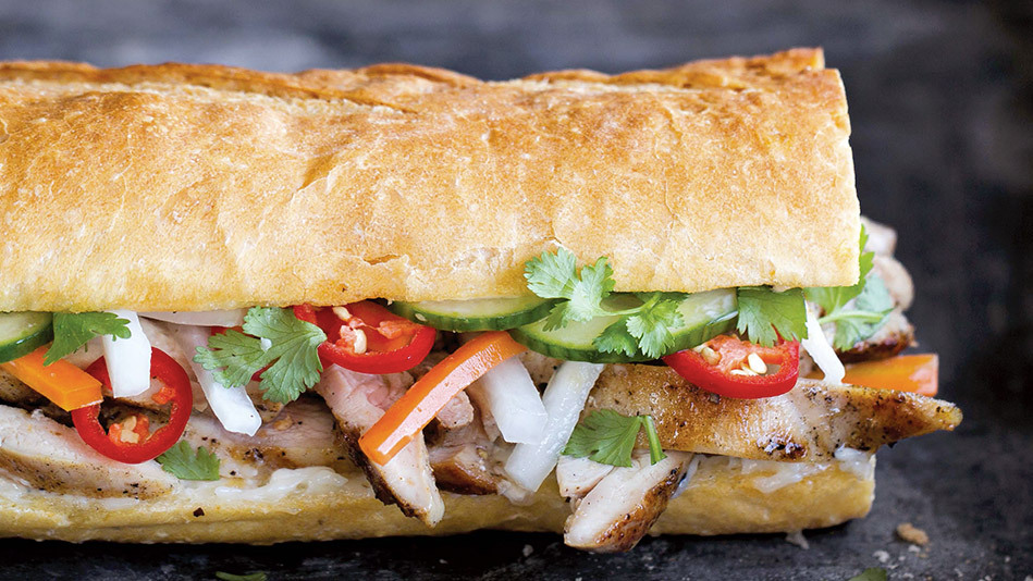 "Banh mi (pronounced ""bun mee"") masterfully combines a crisp baguette with a succulent filling, such as tangy-salty grilled ch"