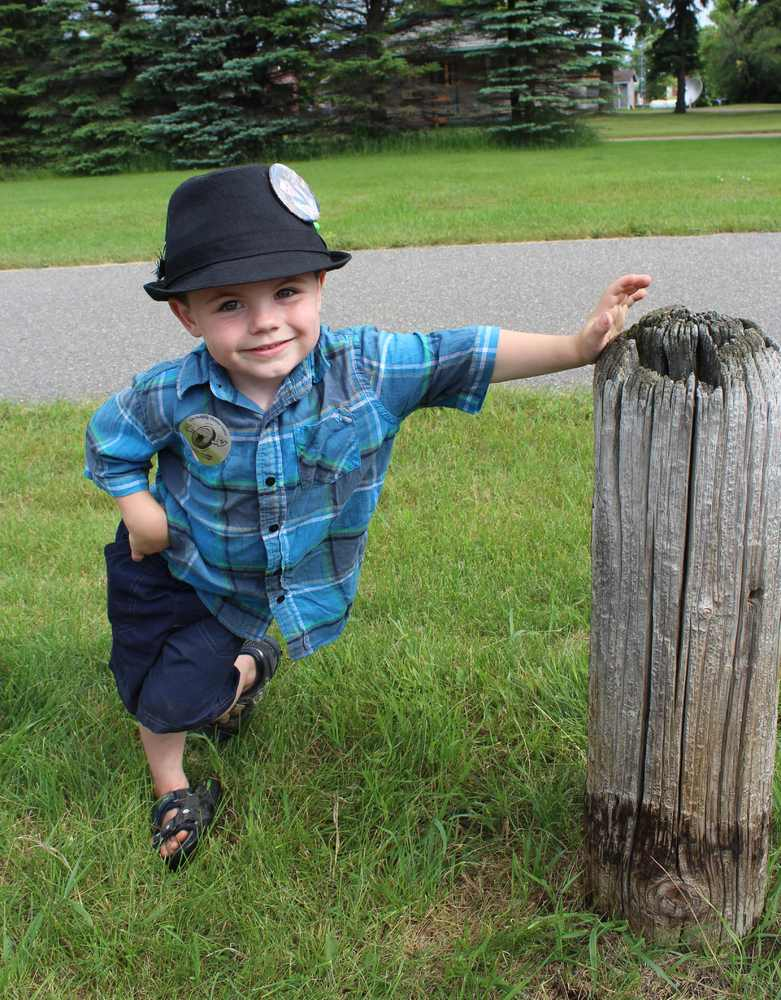 In this photo made Wednesday, June 26, 2013 in Dorset , Minn., Bobby Tufts, the small town's 4-year-old mayor, poses for a ph