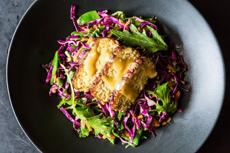 """<strong>Get the <a href=""""http://food52.com/recipes/21554-snow-pea-cabbage-and-mizuna-salad-with-marinated-and-seared-tempeh"""""""