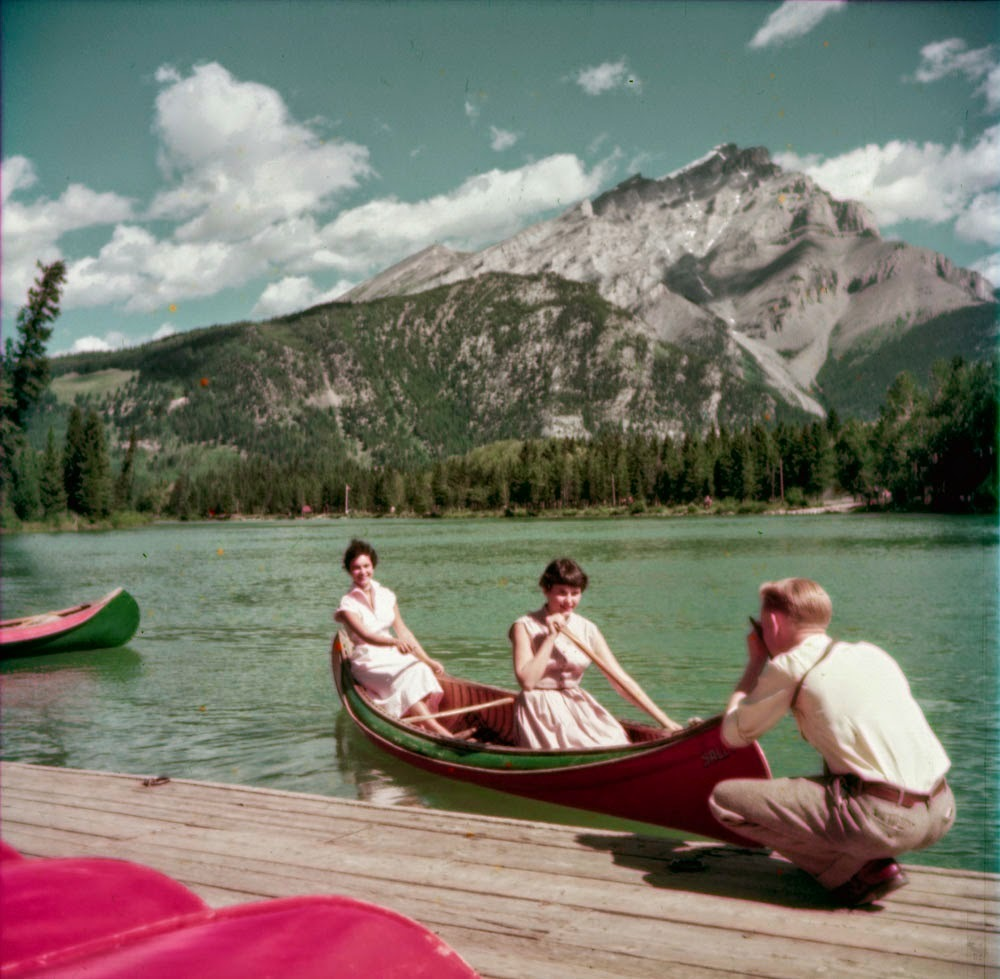 """Canoeing on Bow River at Banff, Alberta.  <a href=""""http://collectionscanada.gc.ca/pam_archives/index.php?fuseaction=genitem.d"""