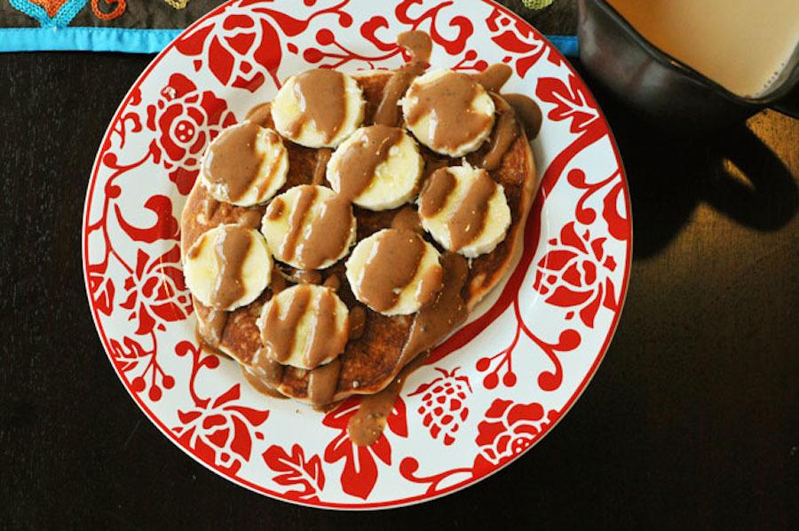 "<strong>Get the <a href=""http://noshandnourish.com/content/holy-carbs-cho-chocolate-pb2-banana-pancakes"" target=""_blank"">Choc"