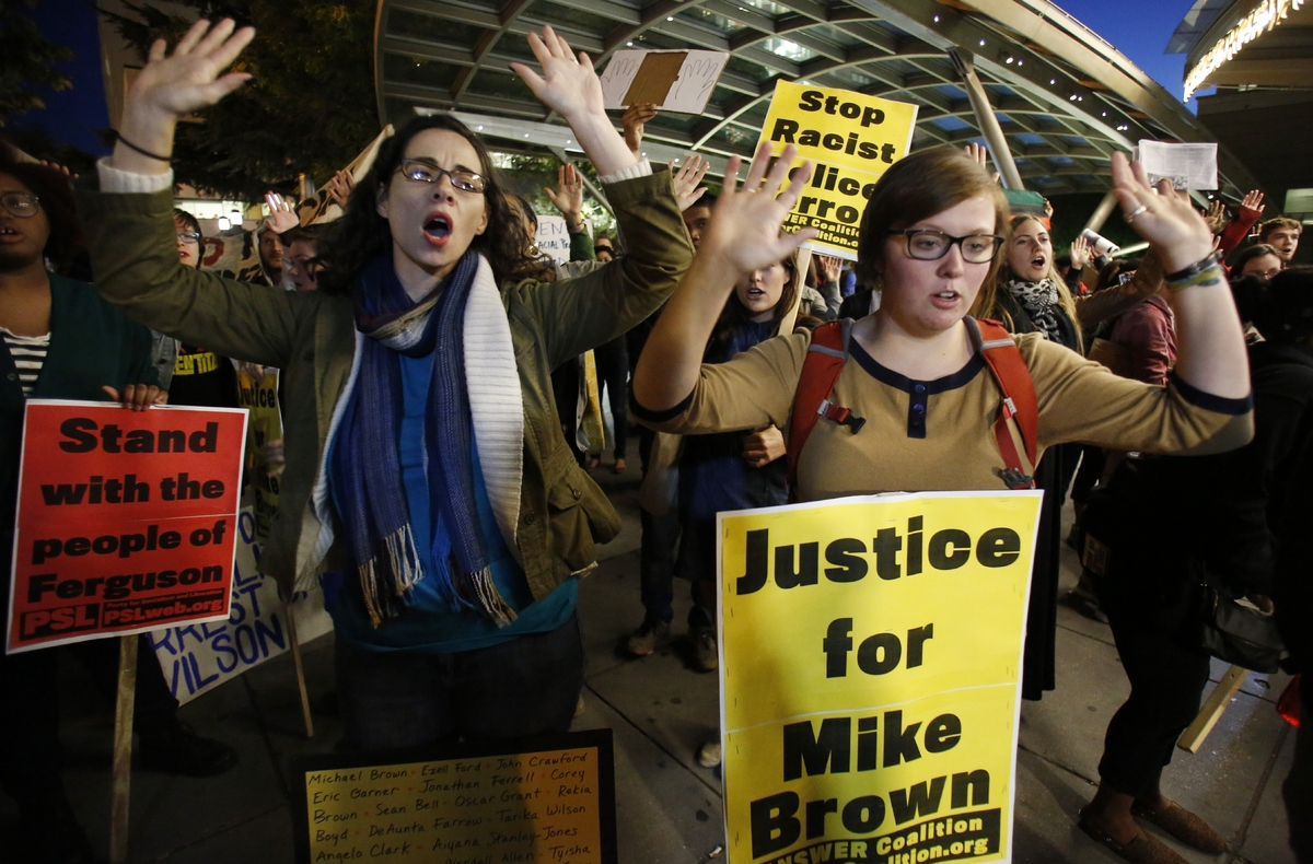 People rally to demand Justice for Michael Brown stand in solidarity with the people of Ferguson and demand police reform in