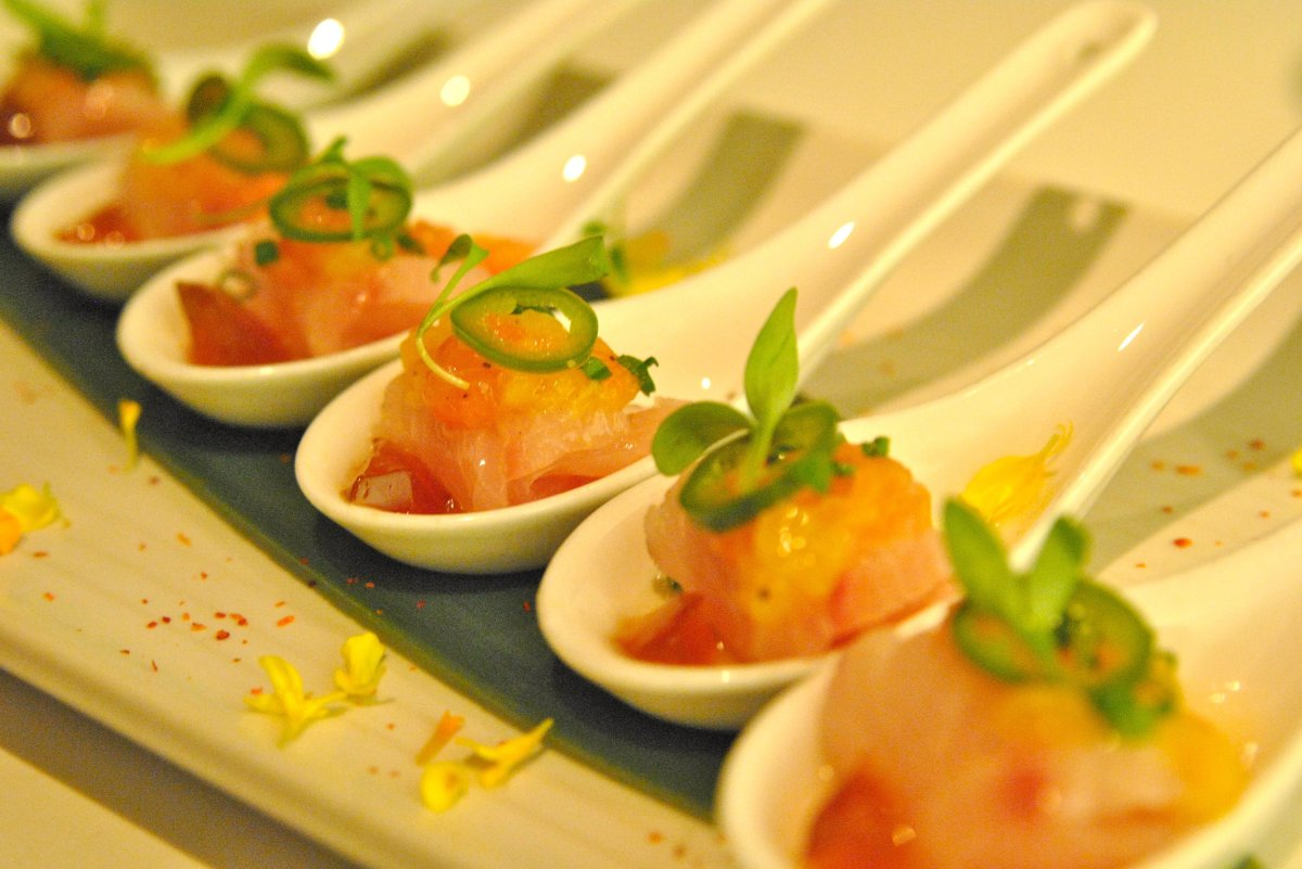 "Spoons of baby yellowtail sashimi in a gelatin ponzu sauce with a citrus kick. (Credit: <a href=""http://oliviakatrandjian.com"