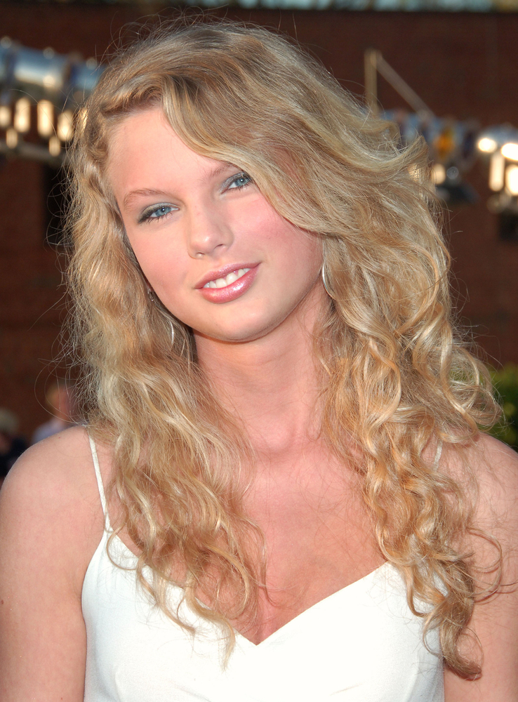 Taylor started out as a fresh-faced teen with natural waves.