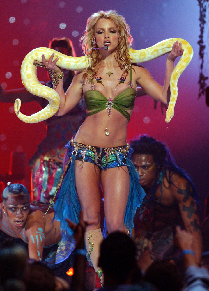 "Britney Spears performs ""I'm a Slave 4 U"" at the 2001 VMAs, with python. (Photo by Kevin Kane/WireImage)"
