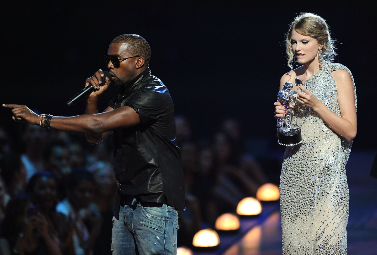 "Kanye West takes the microphone from Taylor Swift onstage during the 2009 MTVs in New York City to say <a href=""http://www.mt"