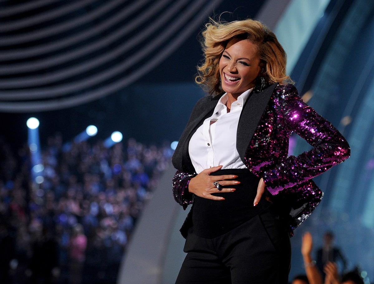"Beyonce performs ""Love On Top"" onstage at the 2011 MTV VMAs and uses the moment to announce her pregnancy. (Kristian Dowling/"