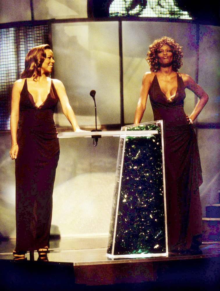 Mariah Carey and Whitney Houston appear together on stage. (Photo by KMazur/WireImage)
