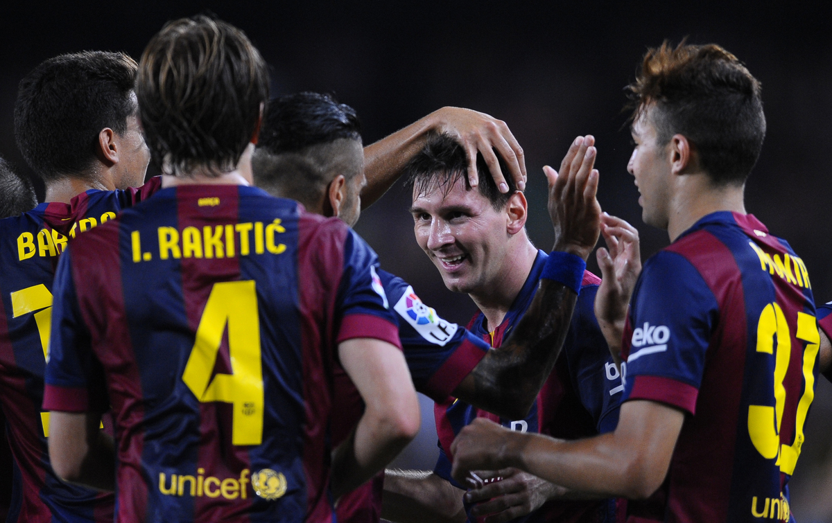 FC Barcelona's Lionel Messi from Argentina, second right, reacts after scoring against Elche during a Spanish La Liga soccer