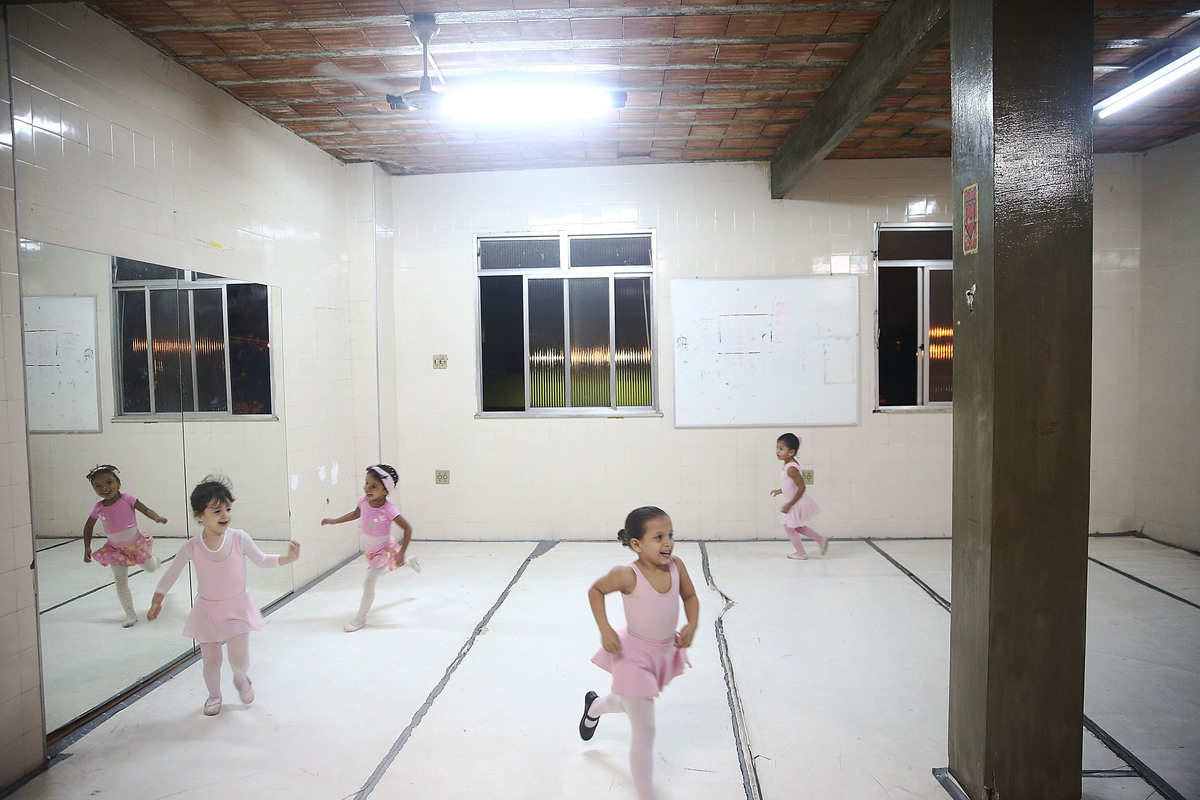 Young ballet students gather during their ballet class at the Museu da Mare in the occupied Complexo da Mare, one of the larg